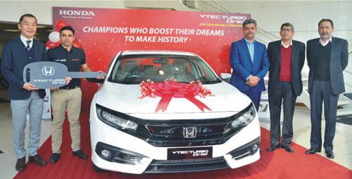Honda celebrates champions