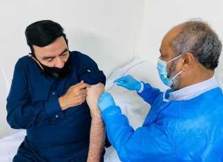 Sheikh Rashid Ahmed receives COVID-19 vaccine
